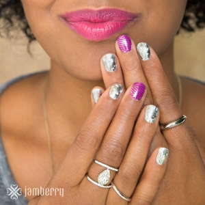 Holographic and purple and silver crisscross on hands